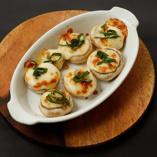 Mushrooms stuffed with cheese & basil