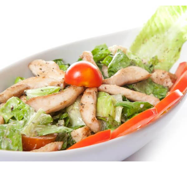 Caesar salad with chicken pieces