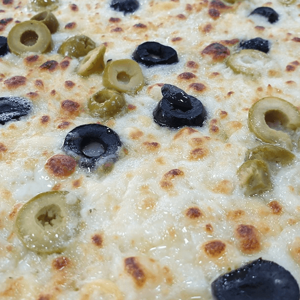 Yellow cheese and olives