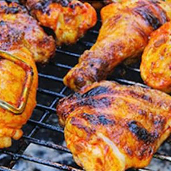 Half grilled chicken on the grill
