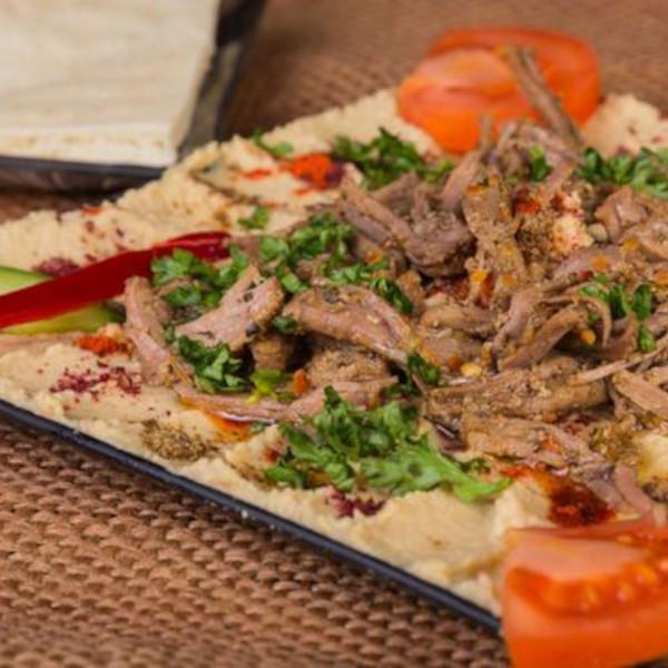 Hummus dish with shawarma