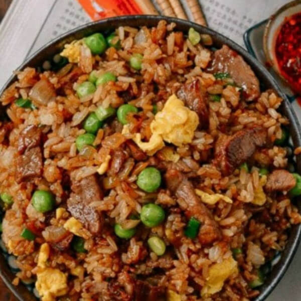 Fried rice with meat (rice - meat - peas - carrots - green onions - soy sauce)